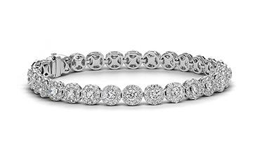 Дорогие золотые стильные браслеты с бриллиантами