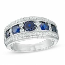 Кольцо из белого золота с сапфирами и бриллиантом