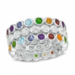 Кольцо из белого золота с цветными камнями и белым топазом