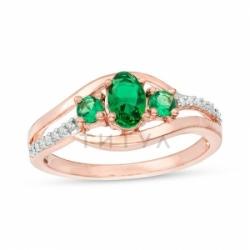 Кольцо из красного золота с изумрудом и бриллиантом