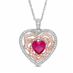 Подвеска в виде сердца из комбинированного золота с рубином и белым сапфиром