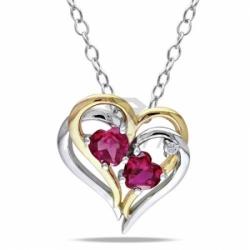 Подвеска в виде сердца из комбинированного золота с рубином и бриллиантом